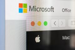 Microsoft and Apple website logos on screen royalty free stock photos