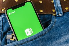 Microsoft Exel application icon on Apple iPhone X screen close-up in jeans pocket. Microsoft office Exel app icon. Microsoft offic. Sankt-Petersburg, Russia royalty free stock photos
