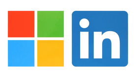 Microsoft and Linkedin logos. Kiev, Ukraine - June 13, 2015: Microsoft and Linkedin logos printed on white paper. Microsoft buys Linkedin social media royalty free illustration