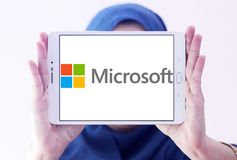 Microsoft logo. Logo of microsoft company on samsung tablet holded by arab muslim woman. Microsoft Corporation is an American multinational technology company royalty free stock image