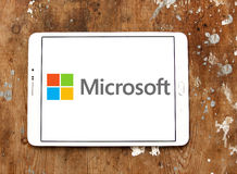 Microsoft logo. Logo of microsoft company on samsung tablet on wooden background stock image