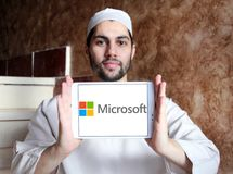 Microsoft logo. Logo of microsoft company on samsung tablet holded by arab muslim man. Microsoft Corporation is an American multinational technology company. It royalty free stock photography
