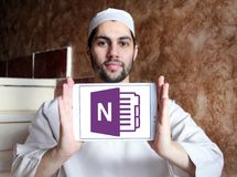 Microsoft office OneNote logo. Logo of Microsoft OneNote on samsung tablet holded by arab muslim man. Microsoft OneNote is a computer program for free form Stock Photography