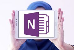 Microsoft office OneNote logo. Logo of Microsoft OneNote on samsung tablet holded by arab muslim woman. Microsoft OneNote is a computer program for free form Royalty Free Stock Photography