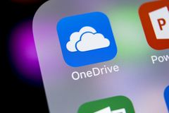 Microsoft OneDrive application icon on Apple iPhone X screen close-up. Microsoft onedrive app icon. Microsoft office OneDrive. Sankt-Petersburg, Russia, March 7 Royalty Free Stock Photography