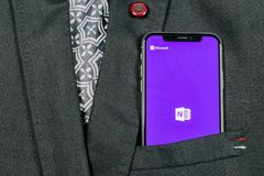 Microsoft OneNote office application icon on Apple iPhone X screen close-up in jacket pocket. Microsoft One Note app icon. Microso royalty free stock photo