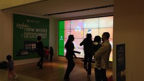 Microsoft staff demonstrates with dance game stock video