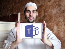 Microsoft Teams logo. Logo of Microsoft Teams on samsung tablet holded by arab muslim man. Microsoft Teams is a platform that combines workplace chat, meetings royalty free stock photos