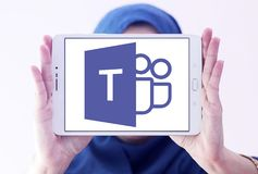 Microsoft Teams logo. Logo of Microsoft Teams on samsung tablet holded by arab muslim woman. Microsoft Teams is a platform that combines workplace chat, meetings royalty free stock image