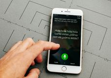 Microsoft Translator on iPhone 7 Plus the application software. PARIS, FRANCE - SEP 26, 2016: Male hand holding New Apple iPhone 7 Plus after unboxing and Royalty Free Stock Images