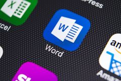 Microsoft word application icon on Apple iPhone X screen close-up. Microsoft word icon. Microsoft office on mobile phone. Social stock photos