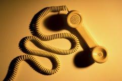 Microteléfono y cuerda de teléfono Fotos de archivo
