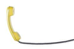 Microtelefono dal telefono della linea terrestre su fondo bianco isolato fotografie stock