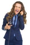 Microtelefono del telefono di taglio della donna di affari immagine stock
