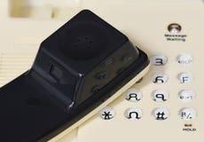 Microtelefono sul telefono del desktop del bottone immagini stock