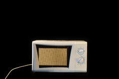 Microwave against black background. Working microwave against black background royalty free stock photography
