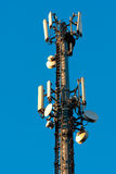 Microwave Antenna. A microwave antenna tower used for telecommunications links royalty free stock photos