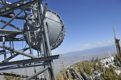 Microwave Antenna on Mtn. Peak Stock Photo