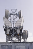 Microwave antenna tower and radomes Stock Photo