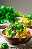 Microwave biriyani in copper bowl Royalty Free Stock Images