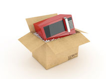 Microwave in cardboard box Royalty Free Stock Image