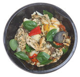 Microwave Chicken Meal. Ready-meal of Lemon Chicken with Basil in a plastic microwave container Stock Photos