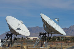 Microwave Dishes. Two Microwave dishes in the mountains of New Mexico Royalty Free Stock Image