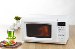 Microwave the home appliance isolated in the kitchen interior Stock Photos