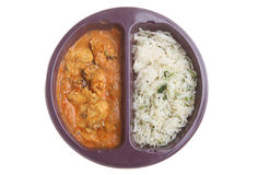 Microwave Indian Curry Meal. Ready-meal of chicken tikka masala curry and rice in a plastic tray Stock Photography
