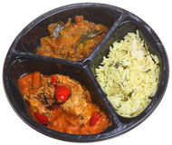 Microwave Indian Curry Ready Meal. Indian chicken jalfrezi with potato curry and rice in a microwavable container Stock Photography