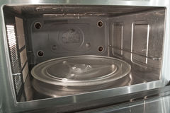 Microwave inside view photo. Glass plate is inserted inside too stock image