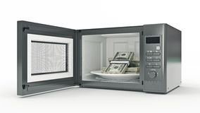 Microwave with money Royalty Free Stock Photo