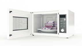 Microwave with money Stock Photos