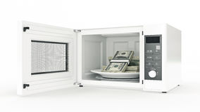 Microwave with money Royalty Free Stock Images