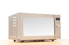 Microwave oven. On the table Stock Photos