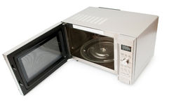 Microwave oven. On the table royalty free stock photos