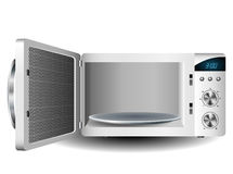 Microwave oven. With open door,  on white background Royalty Free Stock Image