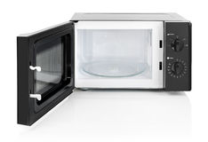 Microwave oven. Black microwave oven with door open, isolated on white royalty free stock photography