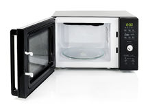 Microwave oven. Black microwave oven with door open, isolated on white royalty free stock images
