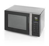 Microwave oven. Black microwave oven isolated on white royalty free stock photo