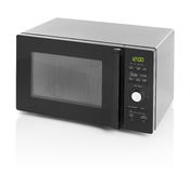 Microwave oven. Black microwave oven isolated on white royalty free stock photos