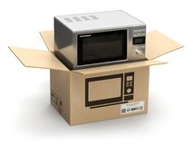 Microwave oven in carton cardboard box. E-commerce, internet onl Royalty Free Stock Images