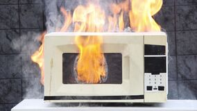 Free Microwave Oven Caught Fire And Caused Domestic Fire. Royalty Free Stock Photography - 216087797