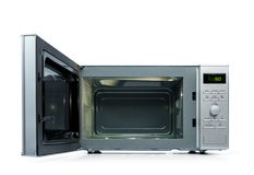Microwave oven with door open, isolated on white background Royalty Free Stock Photo