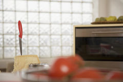 Microwave oven and food in kitchen Stock Image