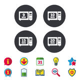 Microwave oven icons. Cook in electric stove. Microwave oven icons. Cook in electric stove symbols. Heat 9, 10, 15 and 20 minutes signs. Calendar, Information Stock Photos