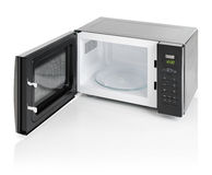 Microwave oven isolated. Black microwave oven with door open, isolated on white stock images