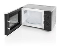 Microwave oven isolated on white. Black microwave oven with door open, isolated on white royalty free stock photos