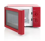 Microwave oven. Red microwave oven with door open, isolated on white Stock Image