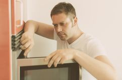 Microwave oven repairing. Royalty Free Stock Photos